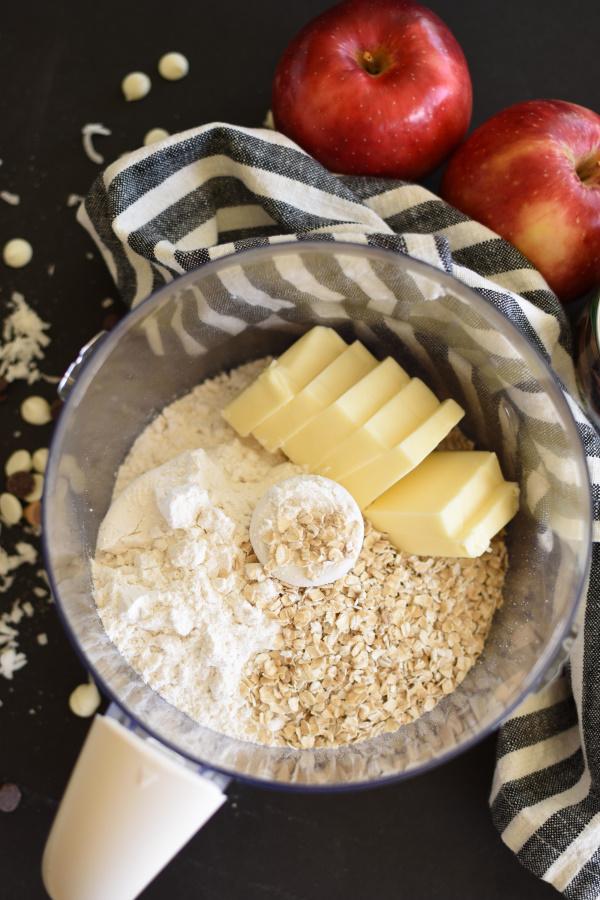 Food processor with oats, butter, flour, and sugar