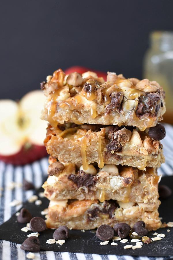 3 caramel apple crisp magic cookie bars in a stack