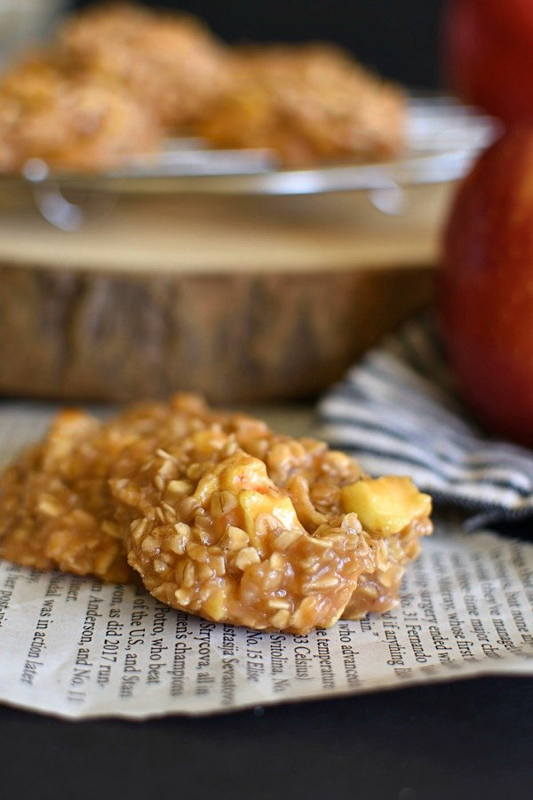 two no bake caramel apple cookies on a piece of newspaper