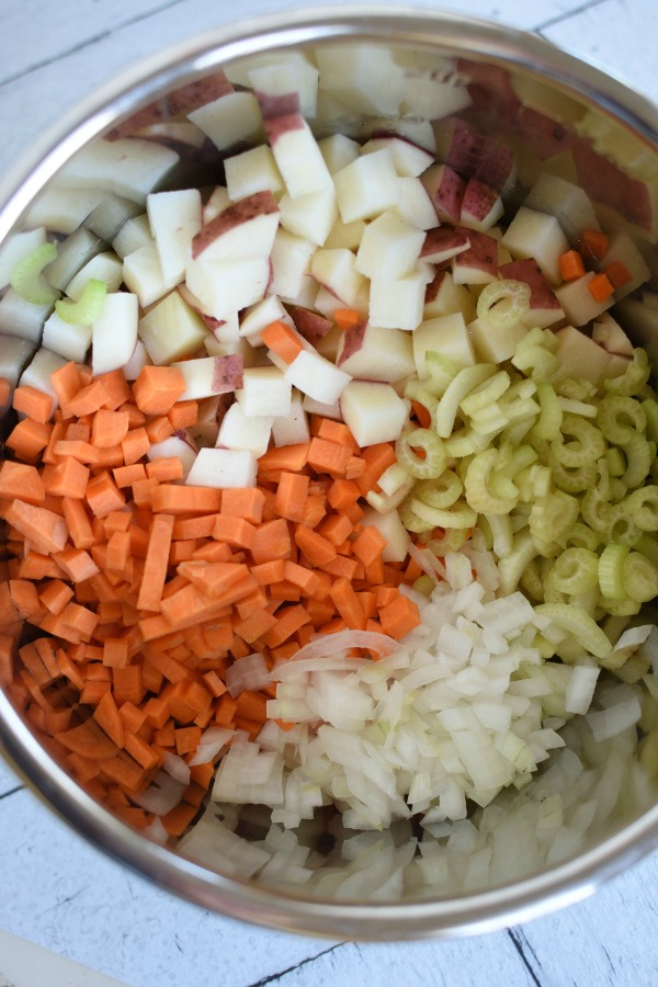 Diced carrots, potatoes, onion, and celery in a pressure cooker