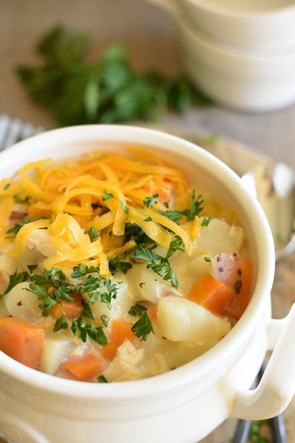 potatoes, carrots, and cheese soup in a bowl