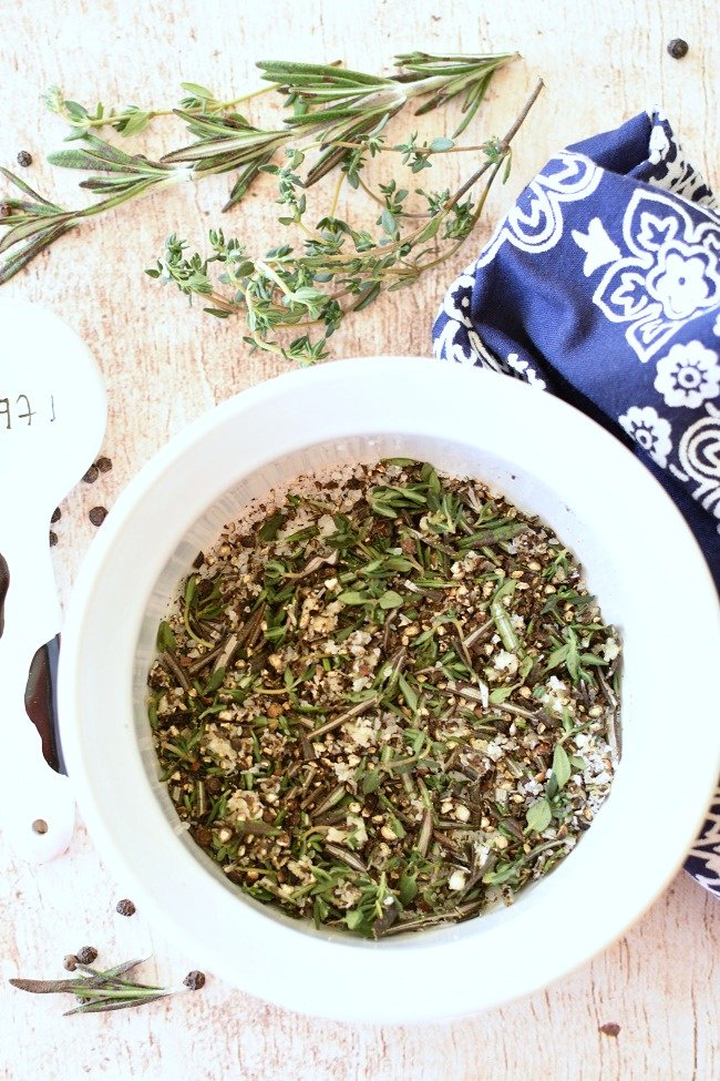 thyme, rosmeary, garlic, salt, and pepper in a bowl