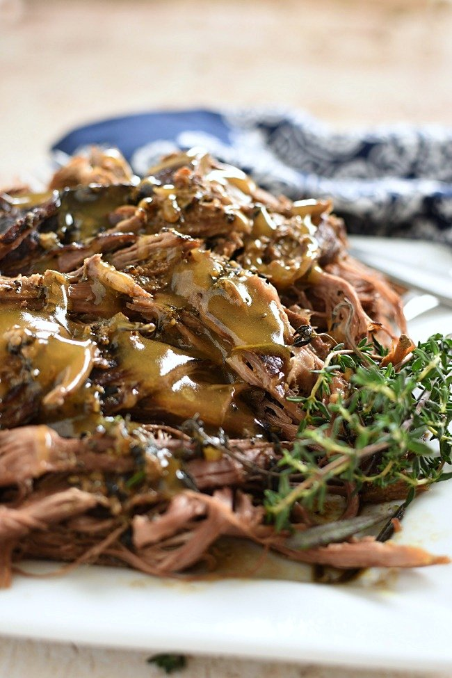 shredded roast beef and gravy on a plate