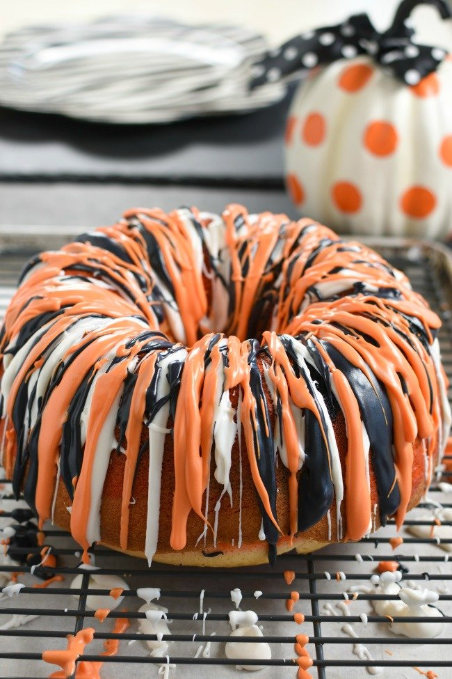 Orange, Black, and White iced Halloween bundt cake on a cooling rack