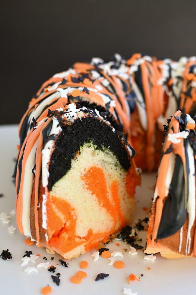 Orange, Black, and white bundt cake cut open