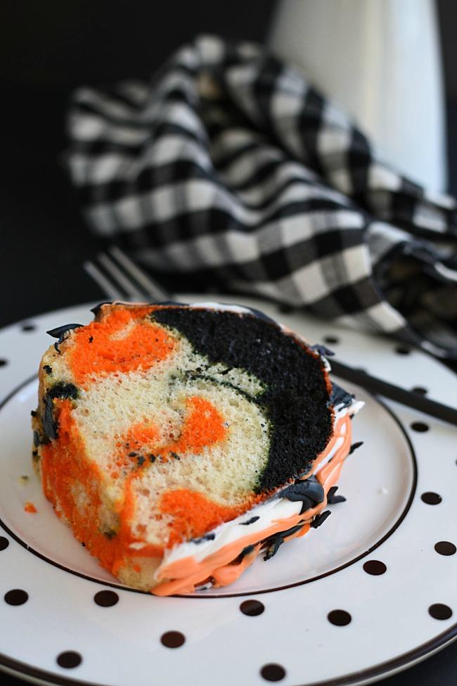 slice of orange, black, and white swirled bundt cake