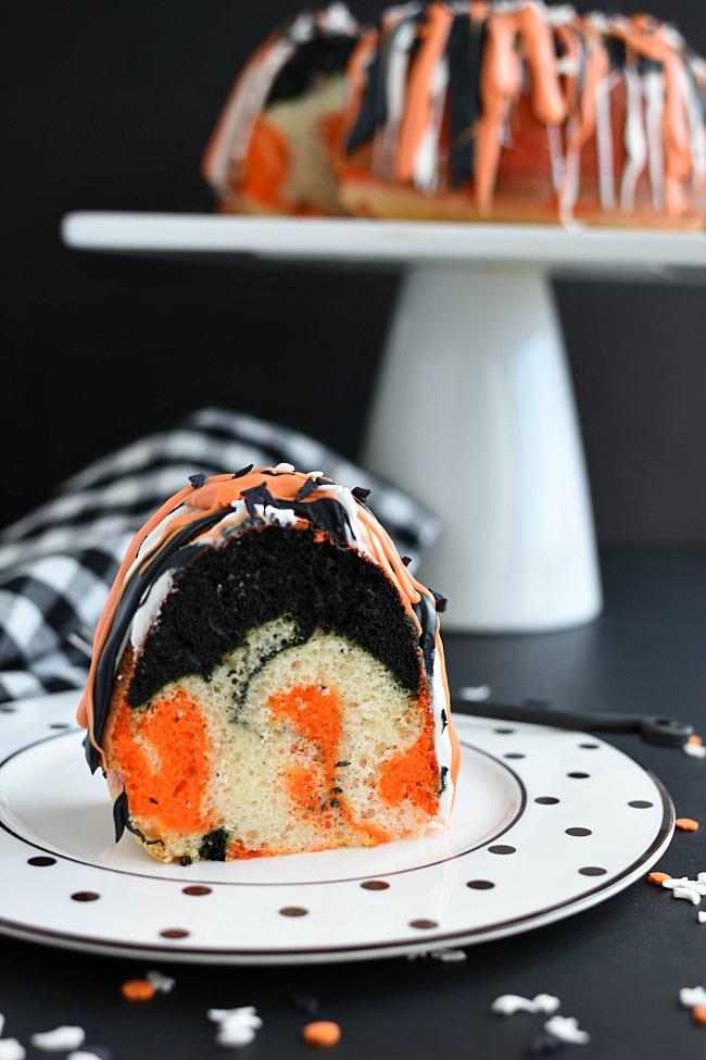 Orange, black, and white swirled bundt cake