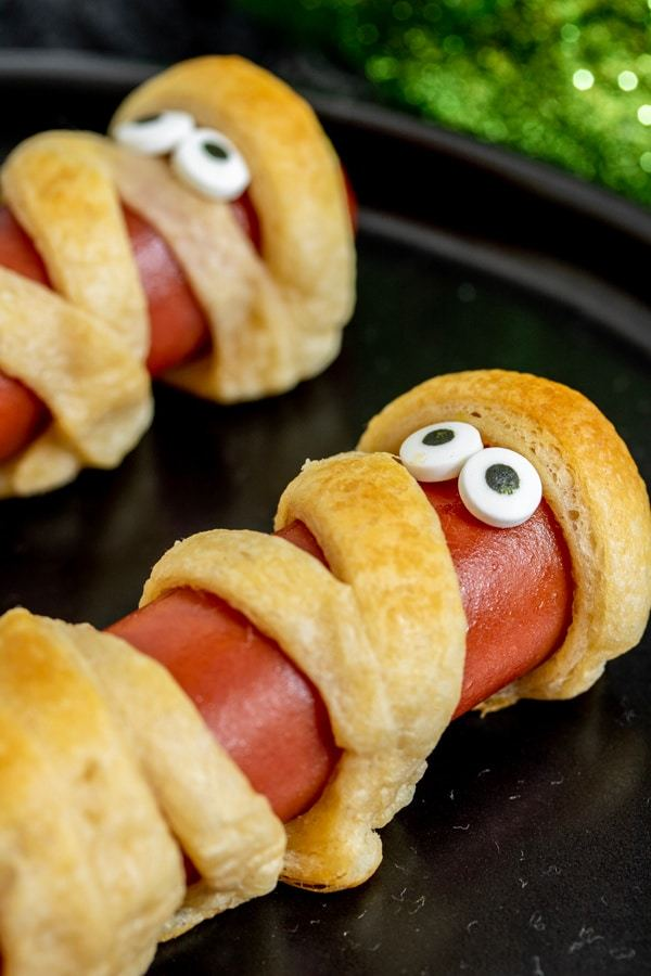 hotdogs wrapped with bread dough to make them look like mummies with google eyes