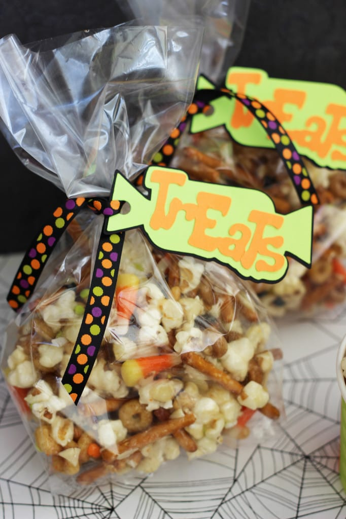 a bag of popcorn mix with candy corns and pretzels