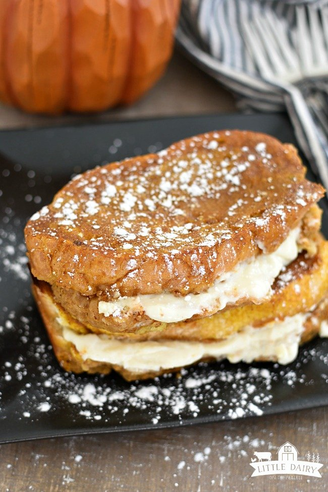 cream cheese stuffed french toast with powdered sugar sprinkled on top