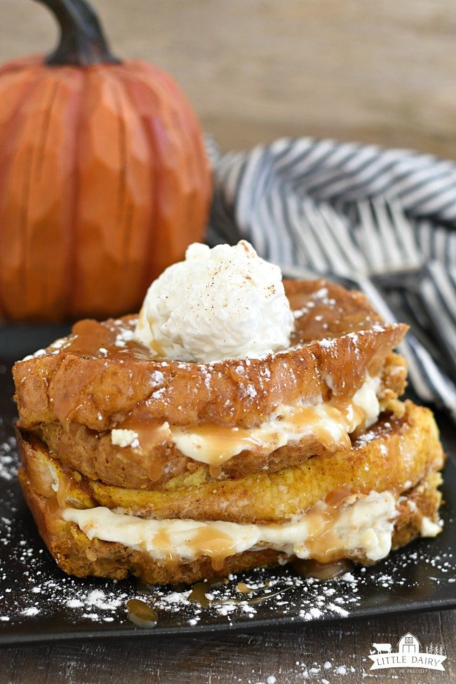 cream cheese stuffed french toast with whipped cream and caramel sauce