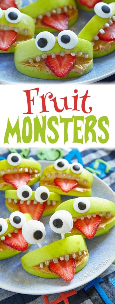 Apple slices decorated with google eyes and teeth, plus strawberry tongues
