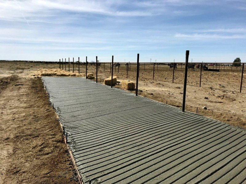 wet concrete and steel posts