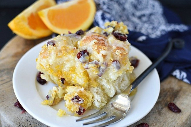 top view of baked, orange glazed monkey bread with cranberries