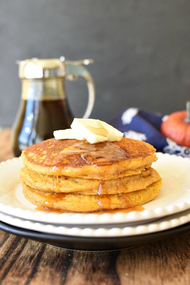 Whole Wheat Pumpkin Pancakes with butter on top