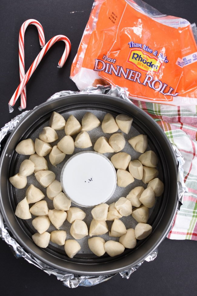 Unbaked rolls in a springform pan