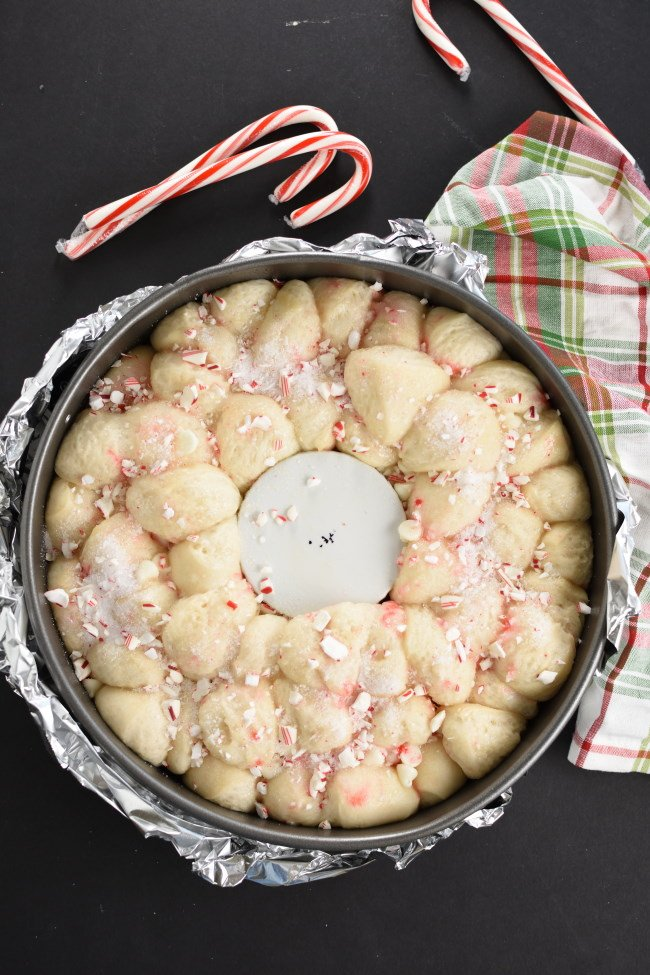 unbaked risen monkey bread with crushed candy canes
