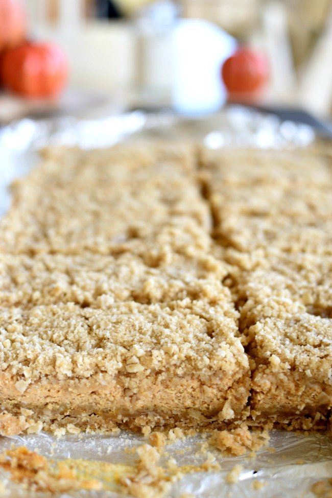 Pumpkin Cheesecake Crumb Bars cut into squares