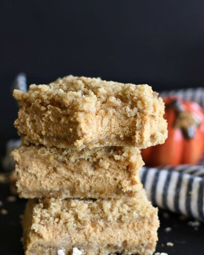 Pumpkin Cheesecake Crumb Bars stacked on each other