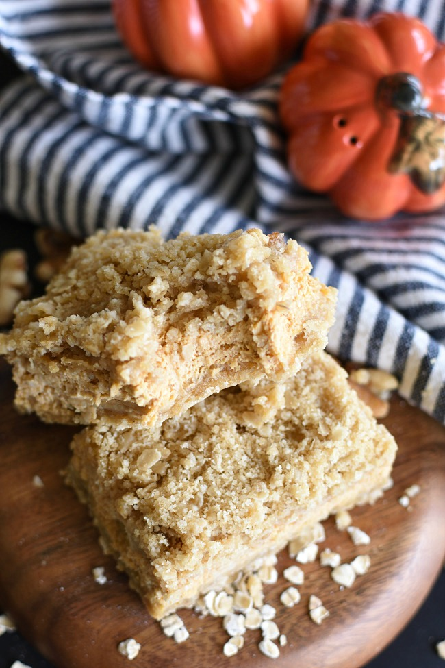 Pumpkin Cheesecake Oatmeal Crumb Bars with a bit taken out of it