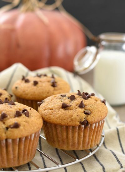 Baked Pumpkin Zucchini Chocolate Chip Muffins on a cooling rack
