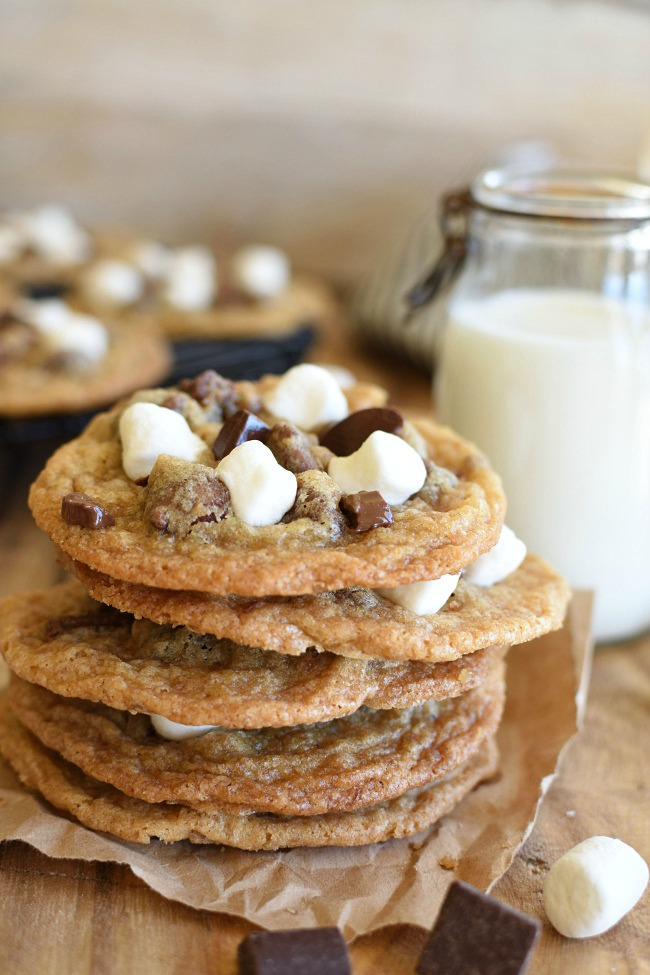 Stack of baked s'mores cookies and milk