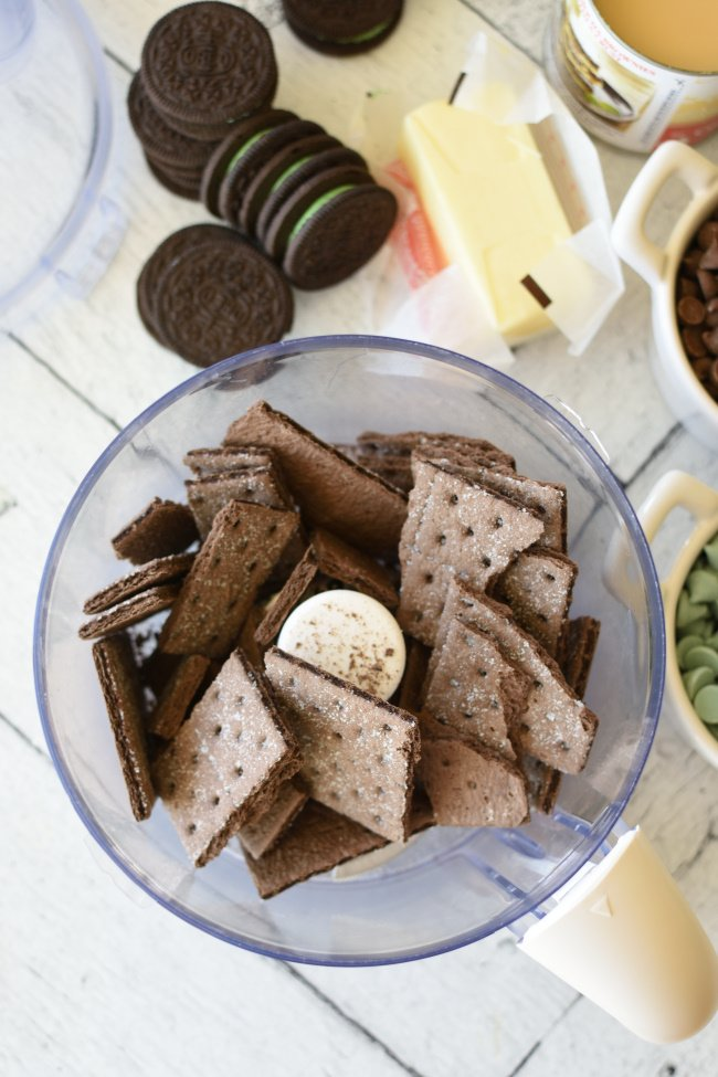 food processor with chocolate graham crackers in it