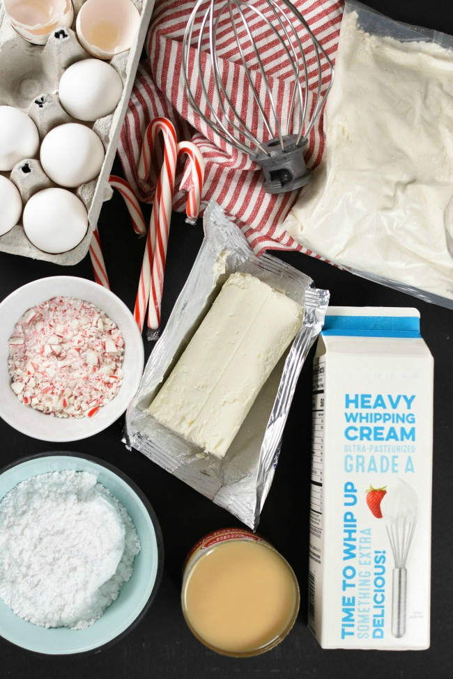ingredients needed to make peppermint poke cake on a black background