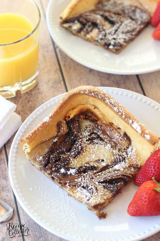 a nutella swirled puffy pancake on a plate