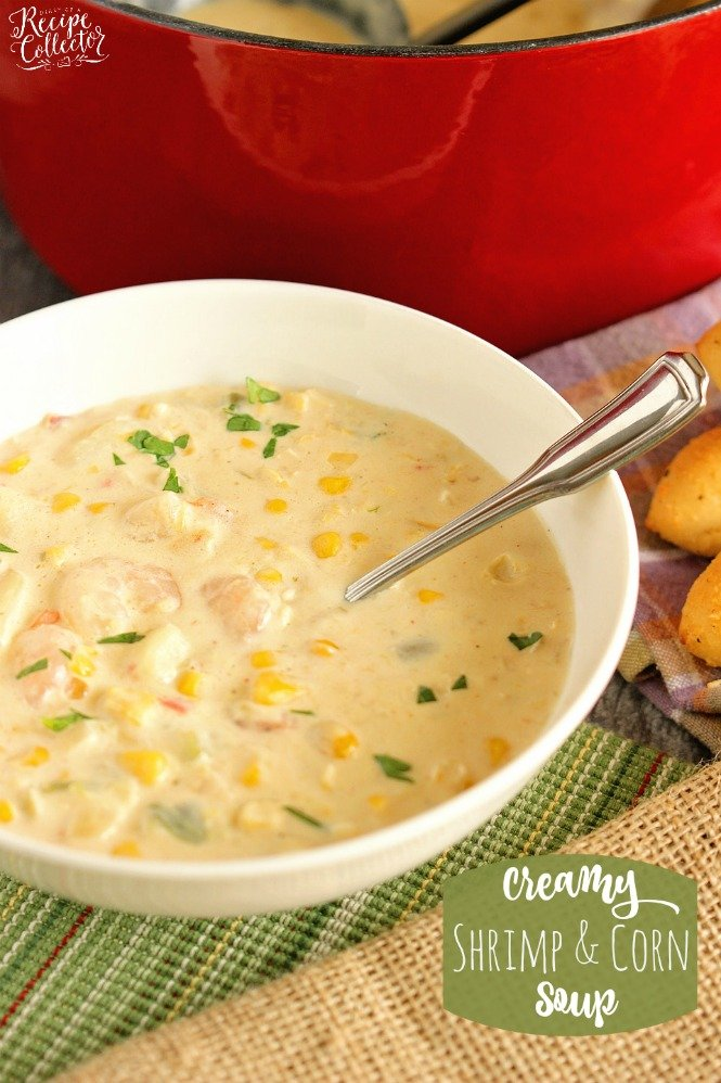 a white bowl with corn and potato chowder sprinkled with parsley