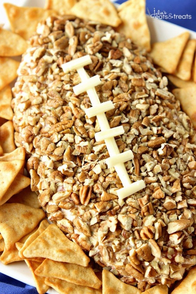 football shaped cheeseball with white cheese laces