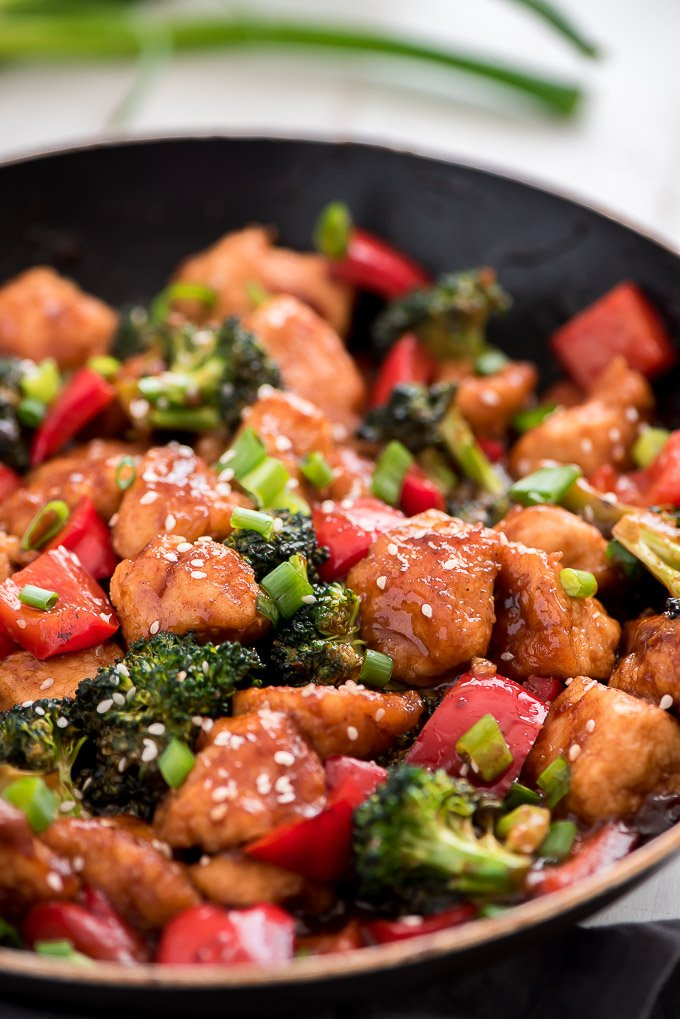 chicken, brocolli, and red peppers in a skillet