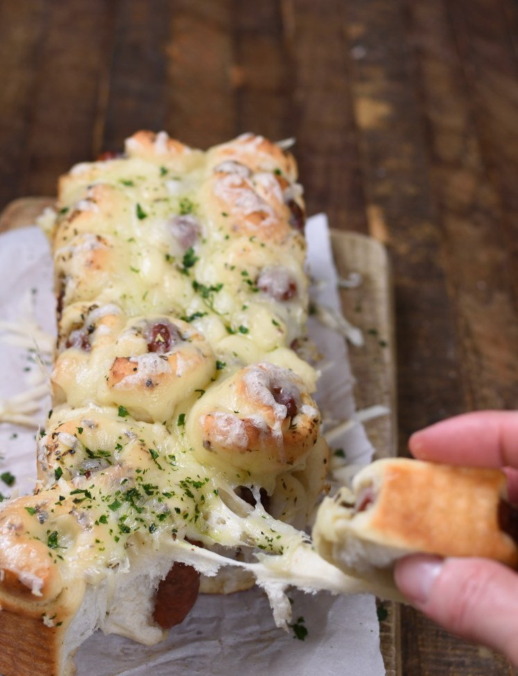 a cheese pull with a chunk of pull apart bread