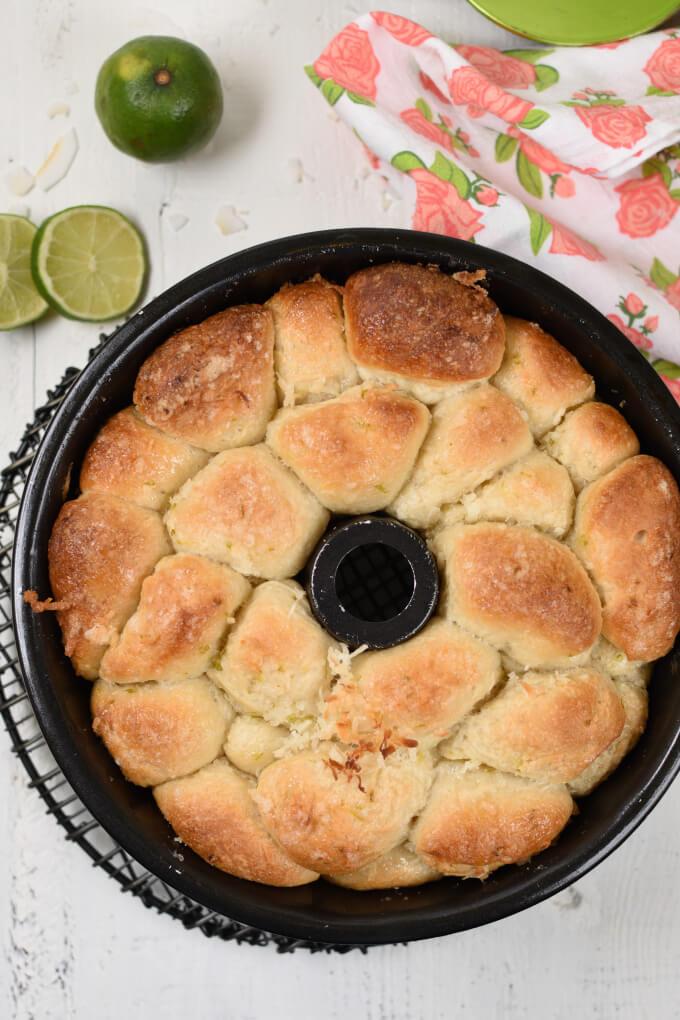 Golden brown baked monkey bread in a black bundt pan