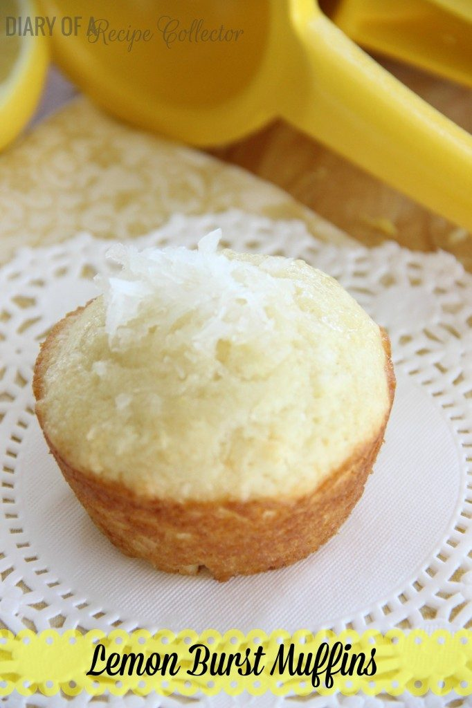 a lemon muffun sprinkled with coconut on a white paper