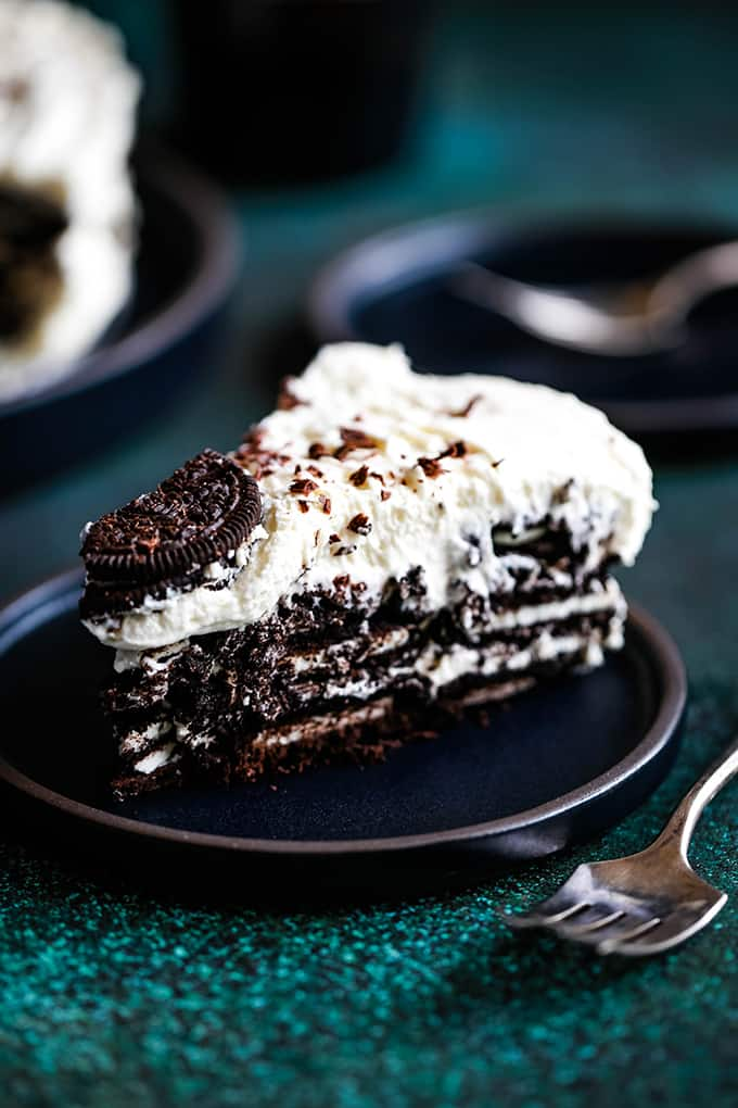 a wedge of icebox cake on a black plate