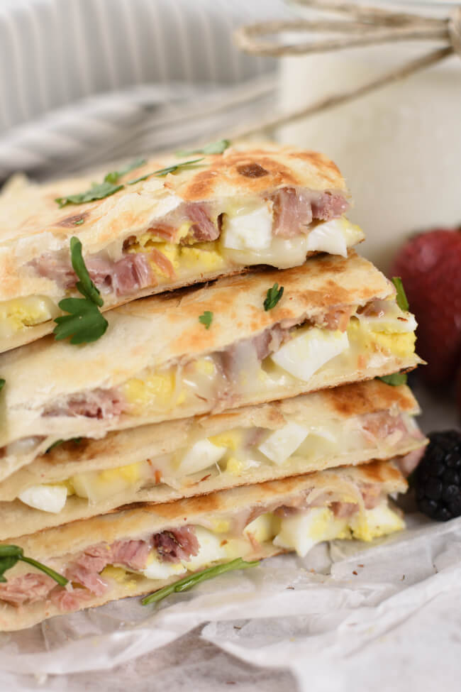 a stack of golden brown quesadillas with melted cheese