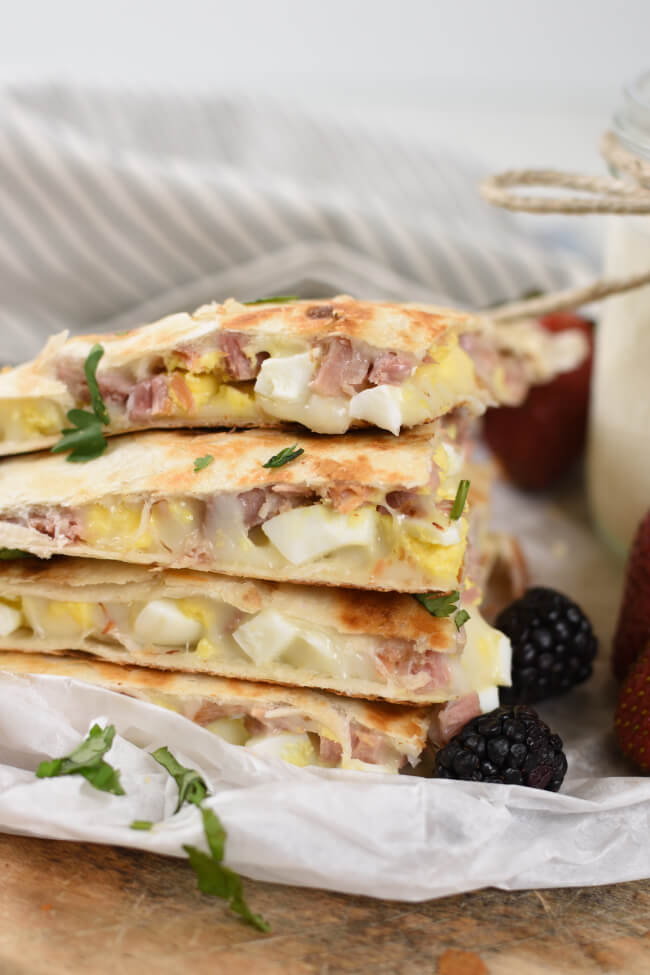 a stack of quesadillas with hard boiled eggs and ham