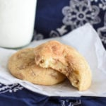 two baked snickerdoodle cookies on a white paper
