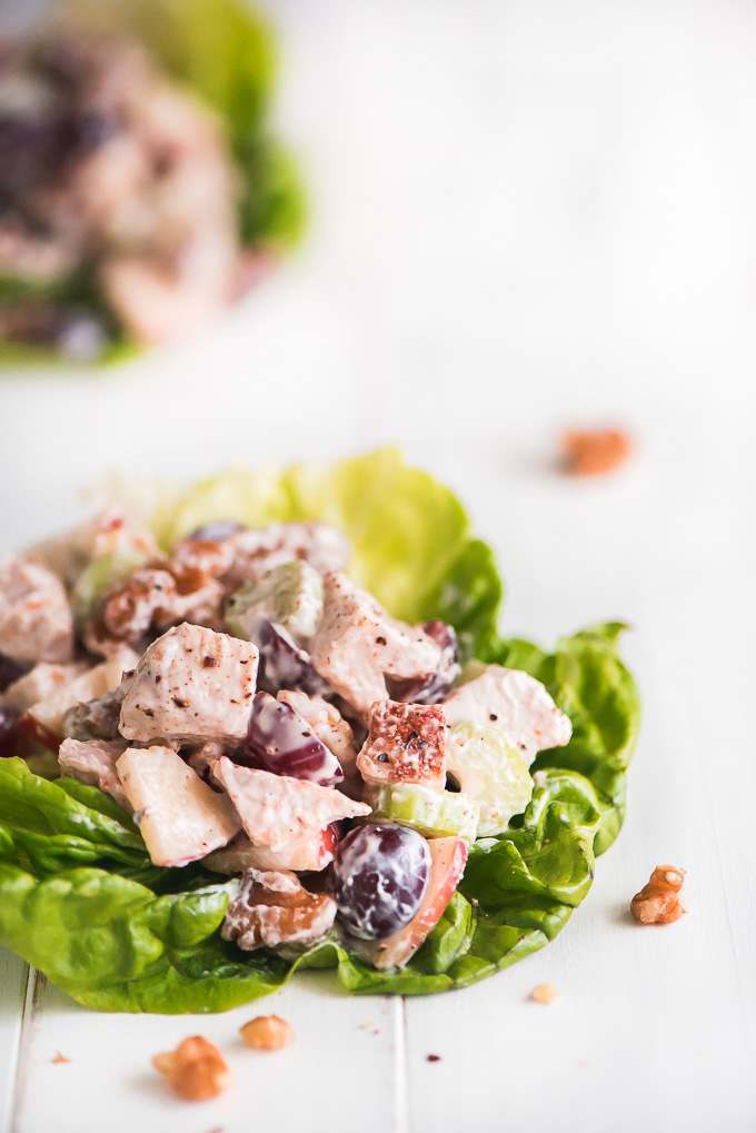 leaves of lettuce topped with chicken waldorf salad