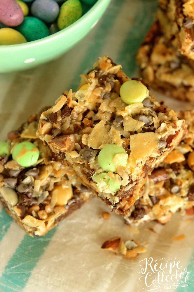 a stack of magic bars topped with chocolate Easter eggs