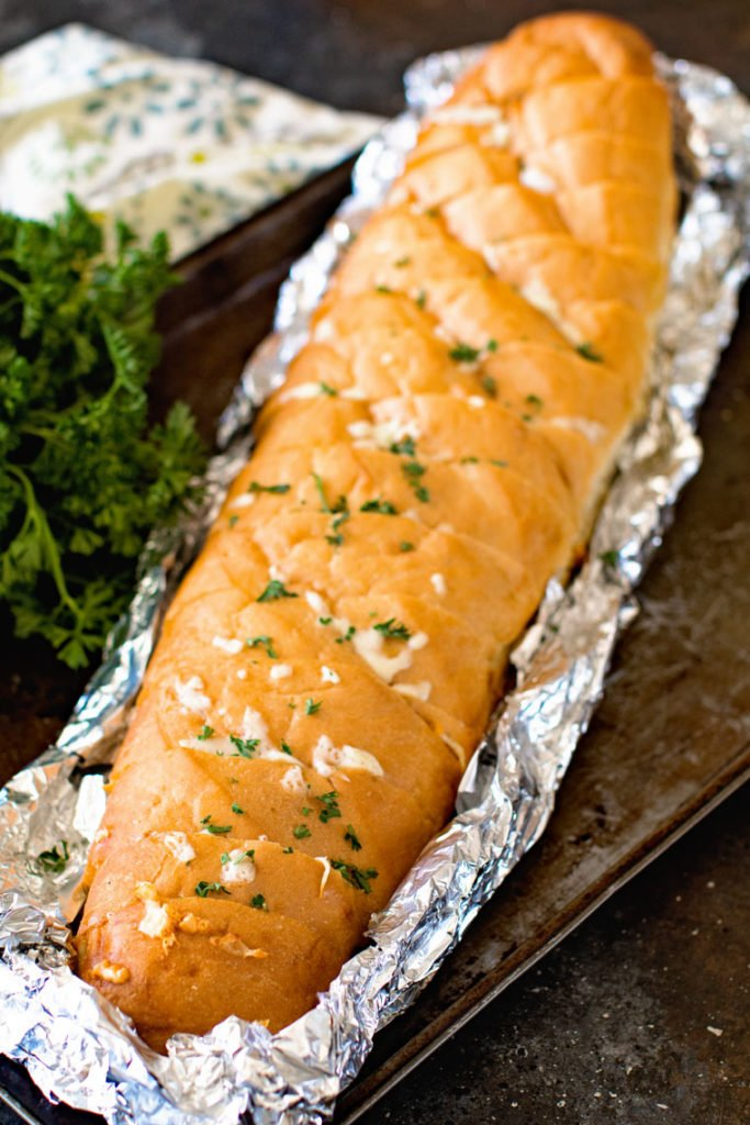 cheese stuffed french bread on a piece of aluminum foil