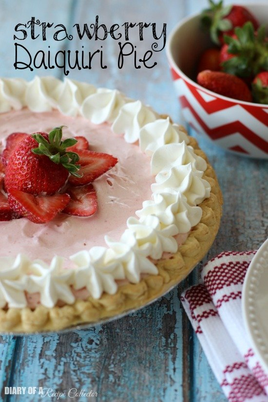 a pink pie topped with fresh strawberries