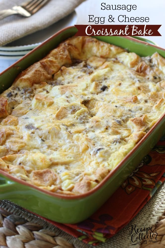 a green baking dish with a cheesy casserole with sausage and bread