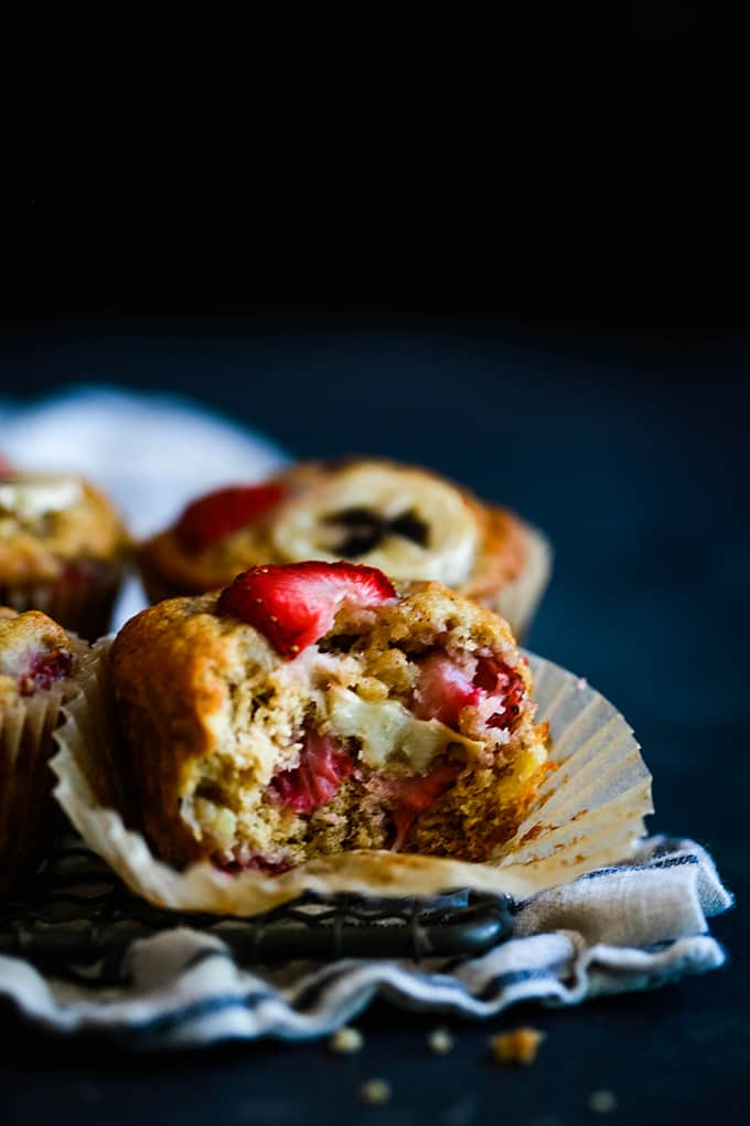 a muffin with strawberries on a white muffin wrapper