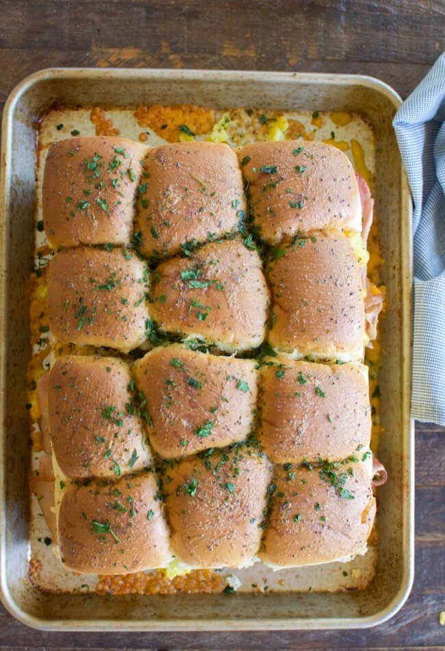 the tops of slider sandwiches sprinkled with chopped parsley