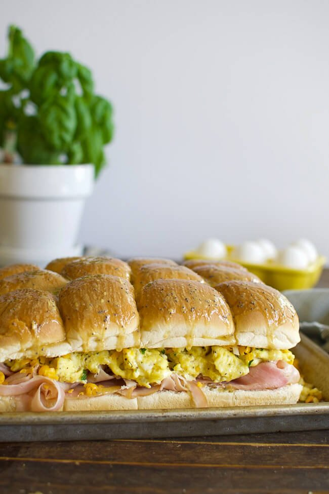 a sheet pan with scrambled egg ham and cheese sandwiches
