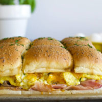 a sheet pan with baked breakfast sliders made on rolls
