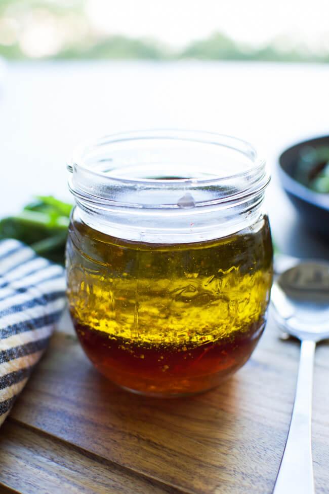 A glass jar with vinaigrette