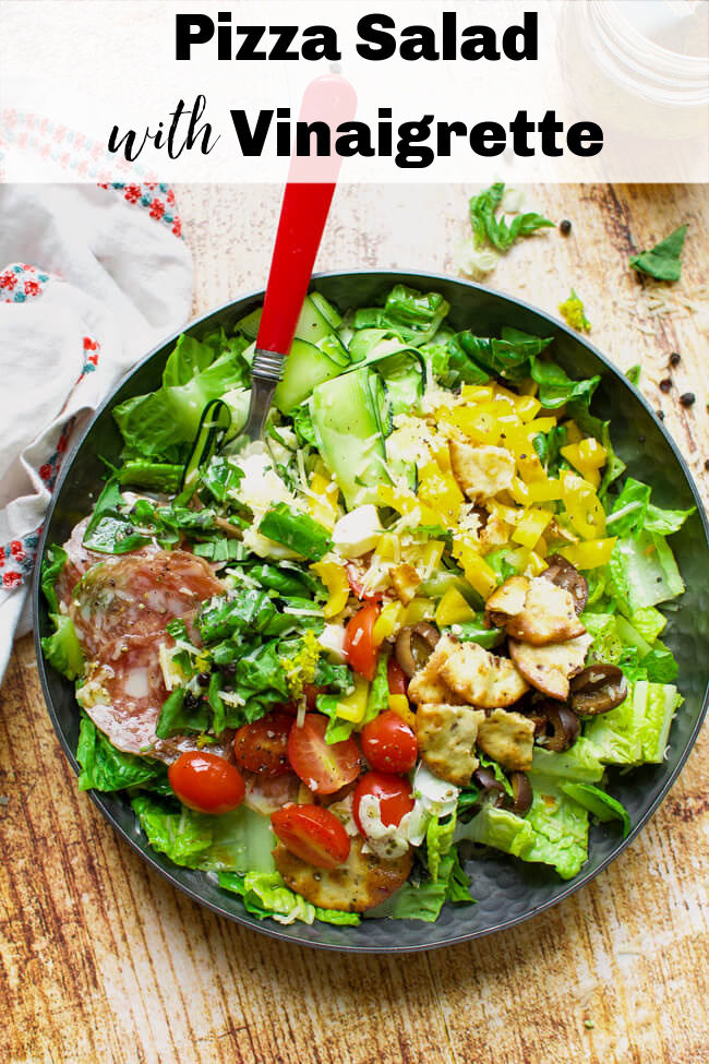 a green salad with pizza toppings.